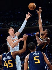 New York Knicks' Kristaps Porzingis, top left, shoots next to Utah Jazz's Derrick Favors, top right, during the first half of an NBA basketball game at Madison Square Garden in New York, Wednesday, Nov. 15, 2017.