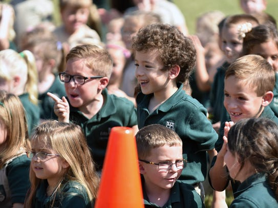 Students of Edgarton Christian Academy watch as members