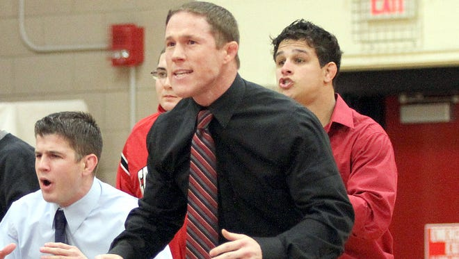 Grand View wrestling coach Nick Mitchell and the Vikings claimed their fifth straight NAIA title on Saturday in Topeka, Kan.