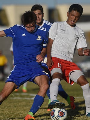 Wooster's Jaime Rodriguez battles Reed's Roberto Bibriezca during their soccer game  on Oct. 31.