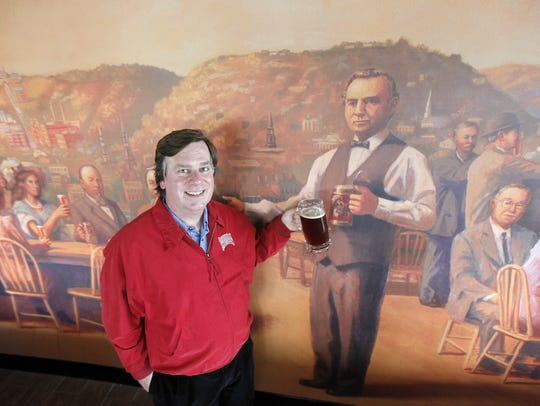 Owner Greg Hardman toasts Christian Moerlein on a mural