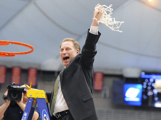 MSU head coach Tom Izzo helps cut down the nets at