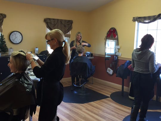 A busy day at SoZo Hair by Bajon Salon and Spa in Olde West Chester's historic business district. Customers packed the newest business along Cincinnati-Dayton Road during the pre-Thanksgiving rush.