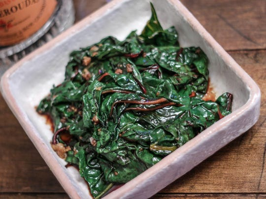Sauté the Swiss chard leaves in olive oil and garlic until just wilted, then add a splash of balsamic vinegar.