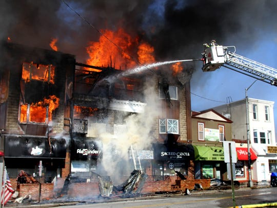 A three-alarm fire consumes three buildings on Brighton Avenue in Long Branch on Feb. 13, 2012