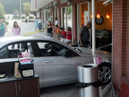 New York State police and Goldens Bridge firefighters work to clear a car that crashed into the Dunkin Donuts / Baskin Robbins in the Goldens Bridge shopping center at Routes 138 and 22 in Goldens Bridge Aug. 6, 2010. (Frank Becerra Jr./The Journal News)
