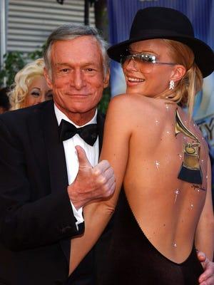 Hugh Hefner and Playboy playmate Zoe Gregory in Los Angeles in 2002.