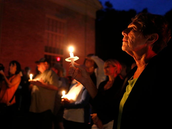 """Rosemarie DiGuglielmo of Dobbs Ferry attends a """"Candles for Clemency"""" vigil near Gov. Andrew Cuomo's residence, Sept. 6, 2014 in New Castle. Over 100 New Yorkers gathered for the vigil and walked to his home urging Gov. Andrew Cuomo to grant clemency to even one of the 55,000 men and women imprisoned in New York State."""