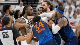 Utah Jazz forward Jae Crowder (99) scuffles with Oklahoma City Thunder forward Paul George (left) and guard Josh Huestis (34) and forward Carmelo Anthony (right) and Oklahoma City Thunder center Steven Adams (second from right) during the second half of game four of the first round of the 2018 NBA Playoffs at Vivint Smart Home Arena.