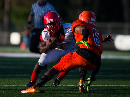 Fred Green, running back, dodges his opponent during