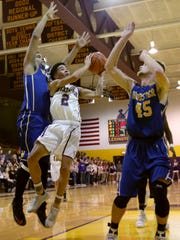 Lexington's Traevin Harrison jumps for the basket against the Wooster defense on Friday night during a conference home game.