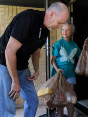 Virginia Nicholls thanks Ralph Goode at the end of his grocery delivery Friday July 7, 2017 in Abilene. Goode works at United Supermarket's Market Street store in Abilene and delivers groceries to customers in the area as part of the store's Streetside program.