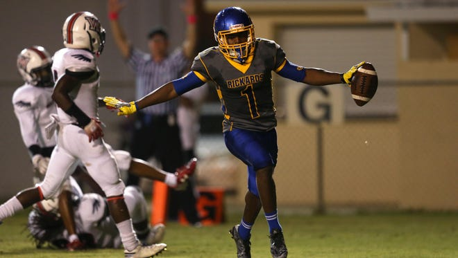 Rickards' Destin Coates celebrates after running for a touchdown against Wakulla at Cox Stadium on Thursday night. Coates had 107 yards rushing and 3 TD in the Raiders' 29-21 win.