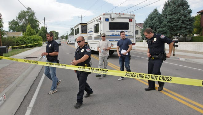 Police officials gather during an investigation after a 12-year-old girl was found dead Friday, July 17, 2015, in West Valley City, Utah. The search for the missing 12-year-old girl is now being investigated as a homicide after West Valley City police discovered the girl's body in a horse pasture. Police Chief Lee Russo says the girl's mother approached two officers at a convenience store near their home around 1:30 a.m. Friday,July 17, 2015. She told officers her daughter had been missing since midnight.