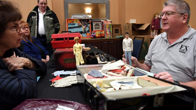 (right) Mark Leinberger appraises Barbie and Ken dolls as Nancy Davis, of River Edge, looks on during the FX Vintage Toy Roadshow at Courtyard by Marriott in Montvale on Saturday, March 17, 2018