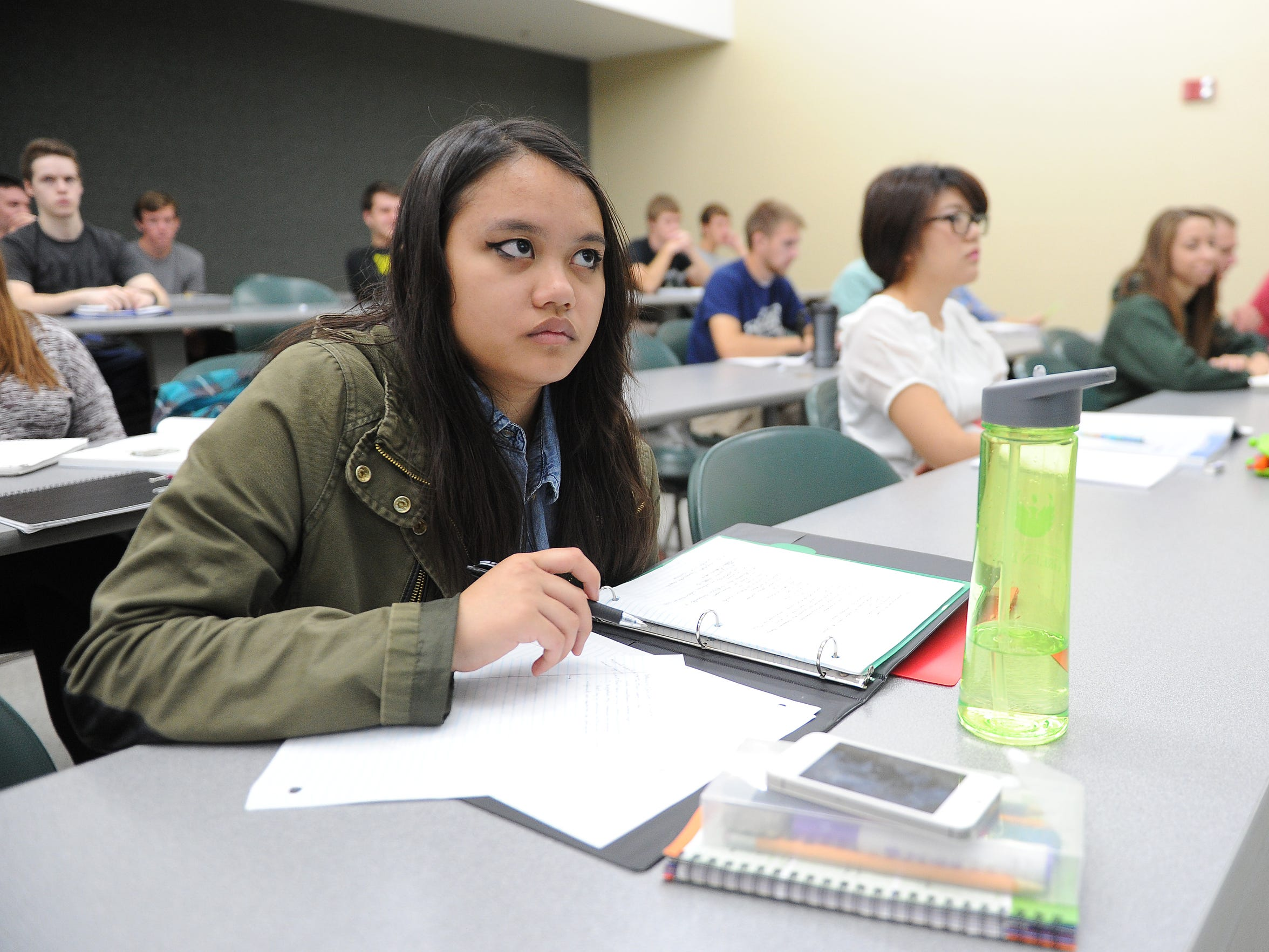 Ives Cupino, a 16-year-old freshman at the University of Wisconsin-Green Bay during a class in Mary Ann Cofrin Hall.