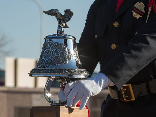 The Las Cruces Fire Department's Honor Guard performing  the of bell ceremony for the fallen first responders that died in the terror attacks of September 11, 2001, Monday September 11, 2017 at Veterans Park.