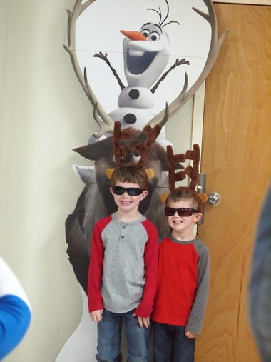 3 Heath and Grayson Stewart pose in front of Olaf Wednesday