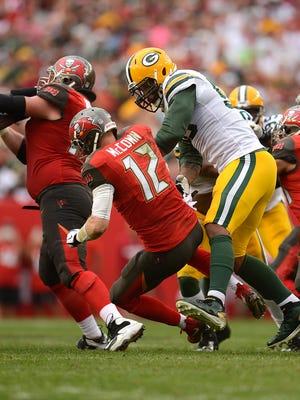Green Bay Packers linebacker Julius Peppers (56) sacks Tampa Bay Buccaneers quarterback Josh McCown (12) in the fourth quarter during Sunday's game at Raymond James Stadium in Tampa, Fla.