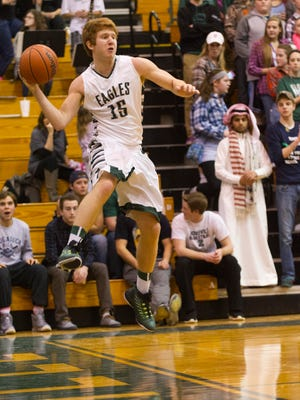Zionsville High School senior Jake Mann (15) saves the ball from going out-of-bounds during the first half of action. Zionsville High School hosted McCutcheon High School in boy's varsity basketball Friday, Feb. 27, 2015.