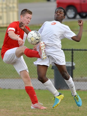 White House Heritage midfielder Tyler Welborn (left) controls a ball in front of Stratford's Mohamed Muday in their match at Stratford on Tuesday. The Patriots won, 4-1.