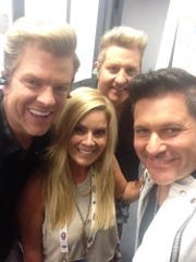 Hair stylist Melissa Schleicher poses with long-time clients Rascal Flatts.