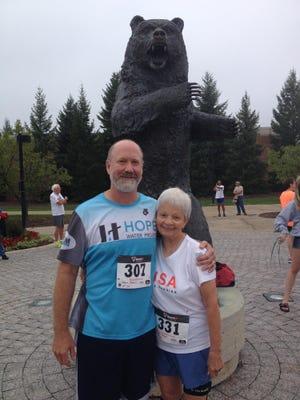 Posing with his mom Dan Dean (left) and Carol Dean before the 2014 Senior Olympics 5K road race held at Oakland University.