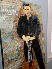 Johnny Cash, set atop a background of his song lyrics,