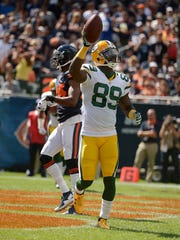 Packers receiver James Jones acknowledges the crowd