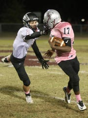 South Side's Tye Baine (2) grabs the facemask of Liberty's Ceadrick Pewitte (17) at Liberty High School on Friday.