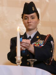 js-1110-VeteransProgram Liberty High School Air Force JROTC Cadet Corps Commander Ellie Holt lights the candle during the POW/MIA ceremony during the Jackson Old Hickory Rotary Club and the Jackson Lions Club's annual Veterans Appreciation lunch at the DoubleTree Hotel, on Monday, Nov. 9, 2015.
