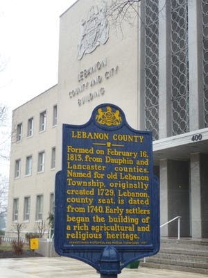 A sign erected in 1981 by Pennsylvania Historical and Museum Commission in front of Lebanon City-County Municipal Building detailing the formation of Lebanon County on Feb. 16, 1813.