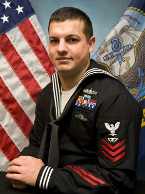 Kewaskum native and Petty Officer 1st Class Shane Harlacher has earned 2015 Sailor of the Year.