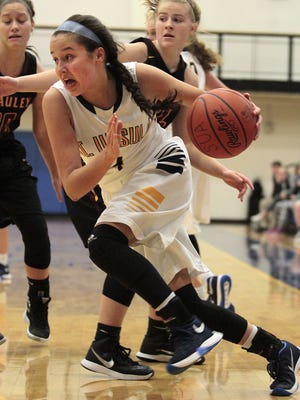 St. Ursula's Megan Bair drives hard along the baseline.