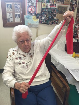 Mary Smith, 96, performs her twice weekly exercises at Physical Therapy & Sports Injury Center.