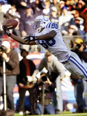 """The finest of his career? Marvin Harrison extends to make a spectacular 42-yard catch in a 2003 game against the Titans. """"One of my favorite moments as a Colt,"""" said Jeff Saturday."""