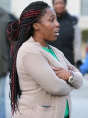 Keanna Mays addresses the crowd after the anti-crime march at the East Pointe Apartment Complex on Friday, Feb. 5, 2016.