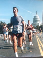 Mike Ball runs in a race in Washington, D.C. The 62-year-old has run a total of 58 marathons.