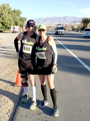 "Manchester Township's Clay Shaw and Karen Mitchell pose before running a marathon in Death Valley last month -- Shaw's 199th. He said the starkness of the treeless landscape reminded him of marathons in the Arctic regions. Death Valley's 70 degree-plus temperatures made it tough-going for a winter marathon. ""It was probably ideal for vacationing but not for running,"" he said."