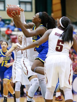 Delaware forward Nicole Enabosi gets through the Elon defense for two points and the first Blue Hen lead of the game with just under three minutes to play in the second half of the Hens' 57-50 win in a CAA tournament semifinal at the Show Place Arena in Upper Marlboro, Md. Thursday.