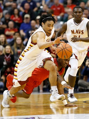 Billy Loft steal the ball from New Albany's Michael Maxwell in the Class 4A state championship Saturday, March 26, 2016, at Bankers Life Fieldhouse in Indianapolis. McCutcheon lost to New Albany 62-59.