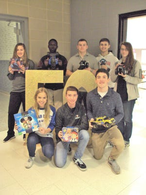 The Cedar Crest High School FBLA collected toys, about 75 items, for the children at the Lebanon Rescue Mission's Agape Family Shelter. Pictured are, from left, back rown, Shianne Martin, Austin Davis, Donovan Pflieger, Dominick Burress, Lara Russell, front row from left, Taylor Menser, Colin Kosko,  and Max Broderic.