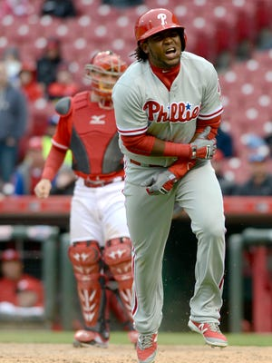 Phillies third baseman Maikel Franco reacts after being hit by a pitch Thursday against the Cincinnati Reds during the ninth inning at Great American Ball Park. Franco was not in the lineup Friday against the Mets.