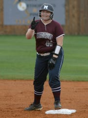 Madison's Anna Cowan gestures after reaching second base against Trinity Christian Academy on Thursday.