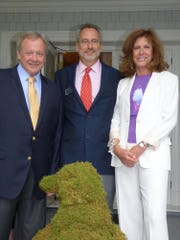 Detroit Zoo executive director and CEO Ron Kagan (center)