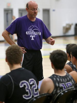 Trinity Christian Academy coach Ken Northcut talks to his team as they take on Tupelo Christian during a Union University basketball team camp at Jackson Christian on Tuesday, June 21, 2016.