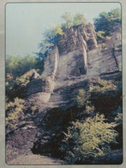 A copy of a state park interpretive sign that was posted on the Gorge Trail in 2010 shows the larger overhanging rock structure, the right side of which collapsed in October 2010.