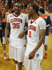 Clemson senior Trevor Booker (35) celebrates with teammate Demontez Stitt (2) after the Tigers win over Georgia Tech on senior night Tuesday, March 2, 2010 at Clemson's Littlejohn Coliseum.