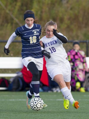 Dryden's Molly Arnold battles for the ball during an IAC Large School girls championship game in 2015.