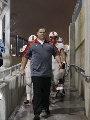 Former La Salle head coach Nate Moore was hit with sanctions Friday, accused by the OHSAA of recruiting former La Salle offensive lineman Thayer Munford to his new team at Massillon.